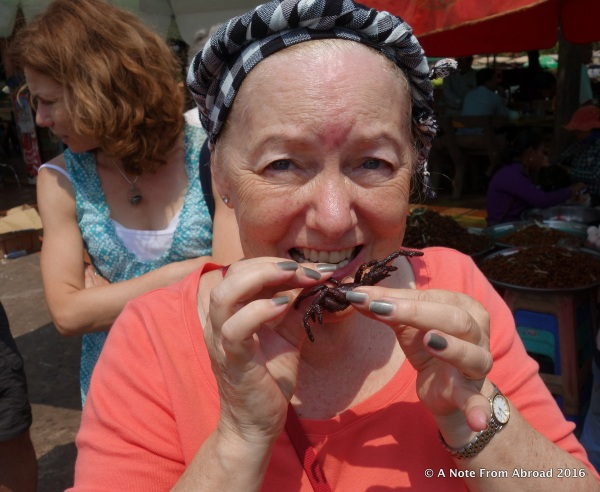 Eating fried tarantula for the first time