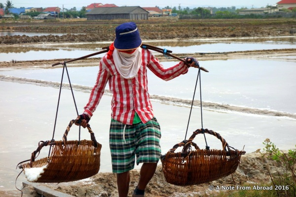Carrying baskets heavy with salt