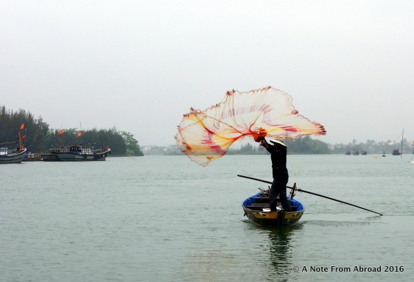 Throwing the net into the air, Hoi An, Vietnam