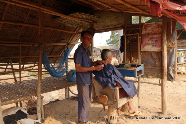 Inexpensive haircuts are offered on the side of the road