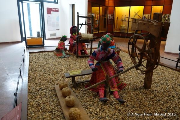 Hmong people weaving hemp clothing