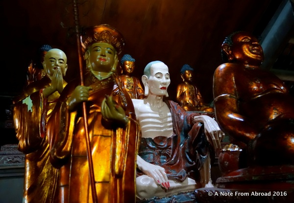 Many Buddhas surround one monk