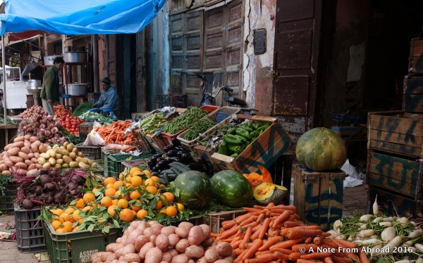 A food stall overflowing with fresh fruits and vegetables