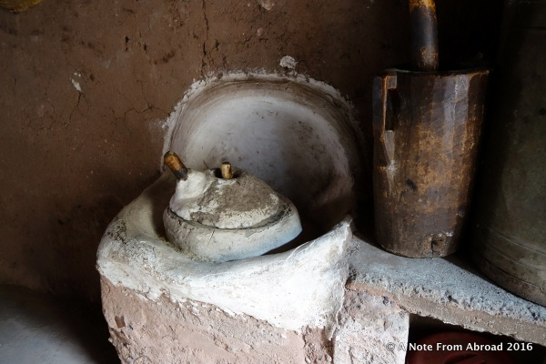 Inside the kitchen where a grinding stone is still in use