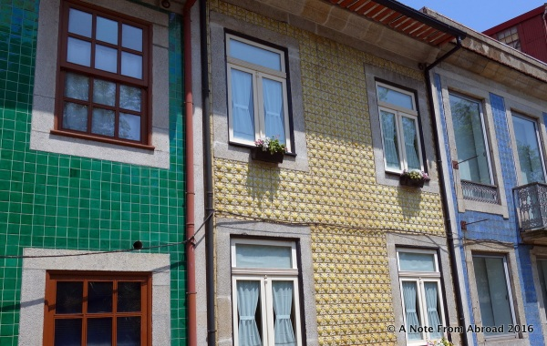 Tile work on the side of buildings is quite common here