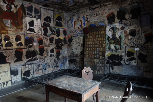Student Jail, old desks and metal beds