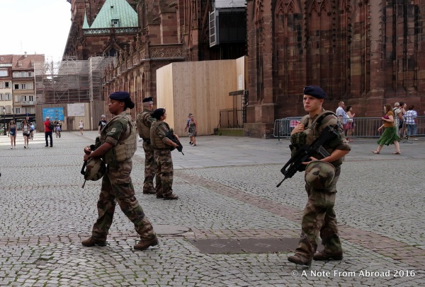 Heavy armed guard presence, especially around the cathedral