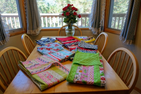 Seven of the finished blankets ready to donate